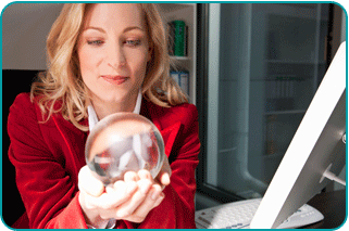 A businesswoman in her office, peering into a crystal ball wondering about her career future
