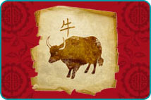 Chinese-style drawing of an ox on parchment over a red patterned background