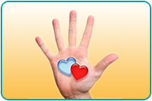 An outstretched hand with two small illustrated hearts in the center of the palm