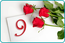 Stylized 9 on envelope with three red roses