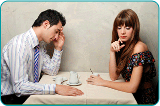 Woman on a disasterous date, wishing she had called her psychic