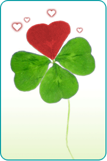 A 4-leaf clover, in which one of the leaves is red, resembling a heart
