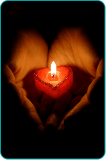 A lit, red, heart-shaped candle resting in a pair of cupped hands
