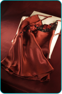 A satin chemise lying on a bed