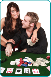 A woman with her arm around a man sitting at a poker table