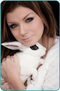 A woman holding a rabbit