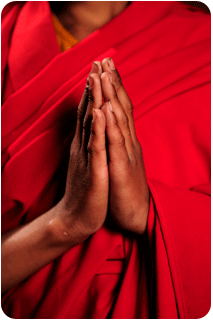 Close-up of the praying hands of a Tibetan monk