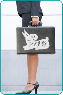 career woman holding briefcase with rabbit design on it