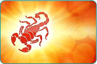 A Scorpio scorpion with a sun starburst behind it