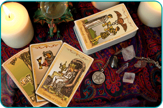A Tarot reader's table with a number of Cups cards showing