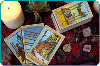 A Tarot reader's table with a number of wands cards showing